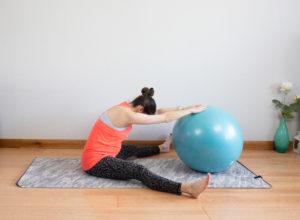 Forward fold on the ball pregnancy safe stretch
